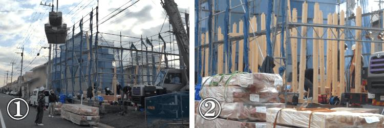 クレーン車と職人による建材の荷下ろしと組み立て
